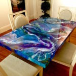 Universe Tables by Bich Nguyen