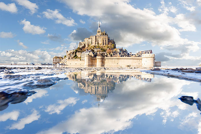 Mont Saint-Michel puddle mirrored by Loïc Lagarde