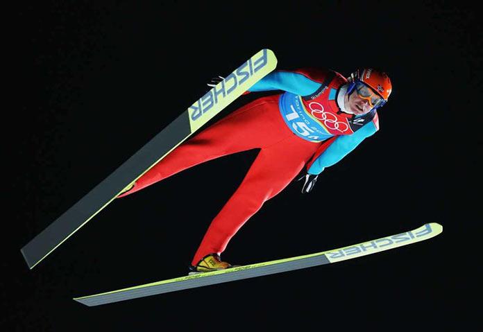 Норвежский прыгун с трамплина Роар Льекельсой на играх 2006 года в Турине, Италия