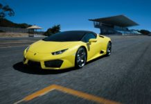 Yellow Lamborghini Huracán RWD Spyder on a racetrack