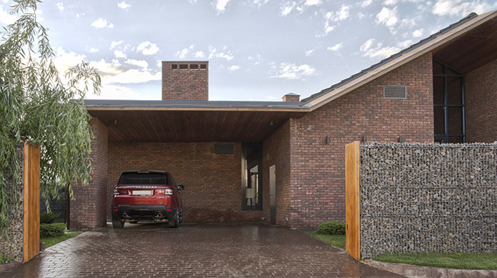 Гараж. Дом в стиле лофт в Ростовской области от архитектурной студии Чадо