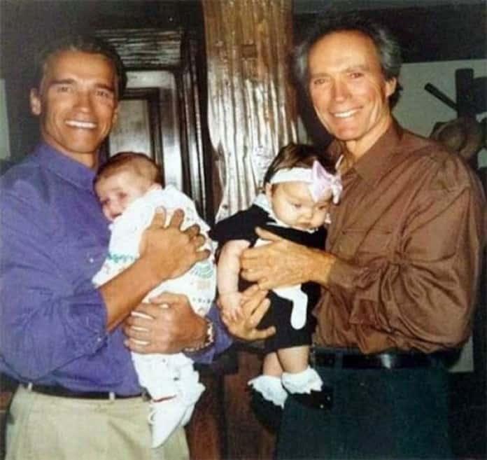 Арнольд Шварценеггер и Клинт Иствуд с маленькими дочерьми